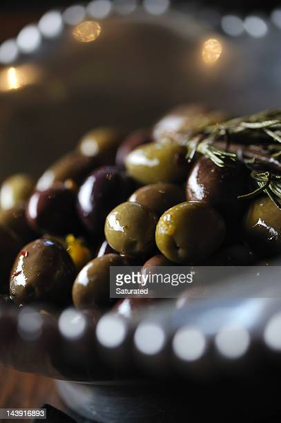 green and black olives in silver bowl - spanish olive stock photos and pictures