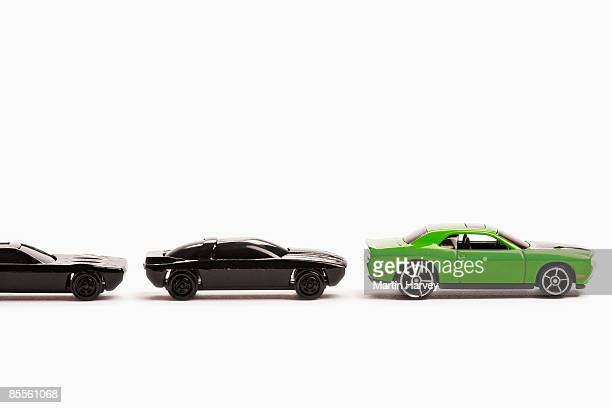 Green and black toy cars.