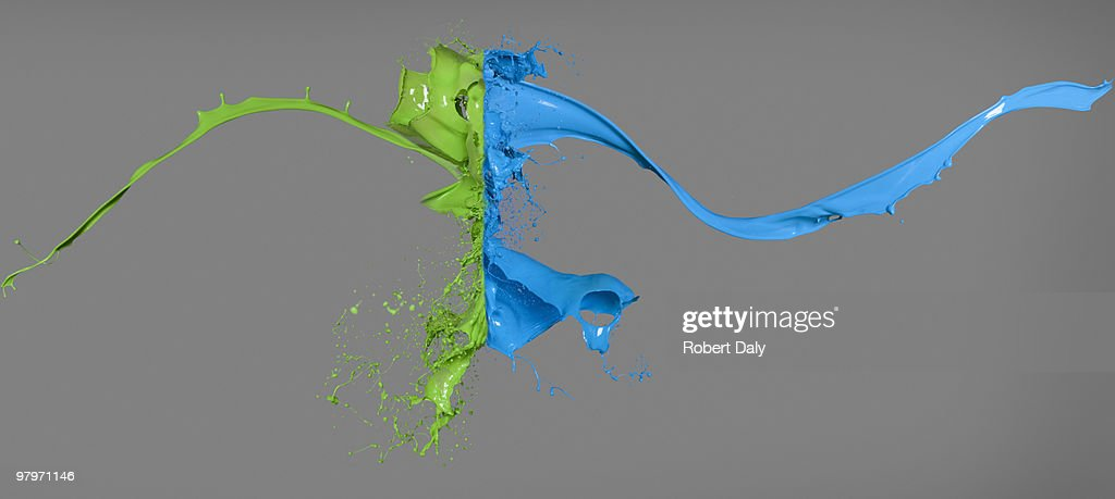 Green and blue paint colliding : Stock Photo