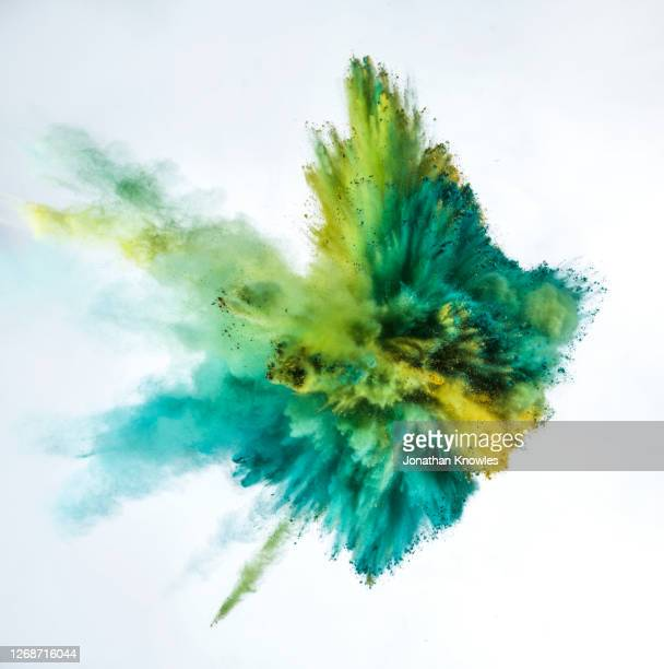 green and blue powder explosion - green colour stock pictures, royalty-free photos & images