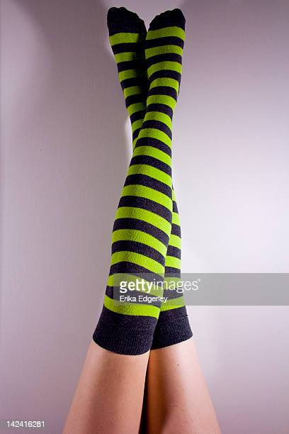 green and grey striped socks - legs crossed at ankle stock pictures, royalty-free photos & images
