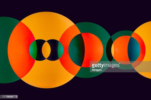 green and orange circle overlapping - circle stock pictures, royalty-free photos & images