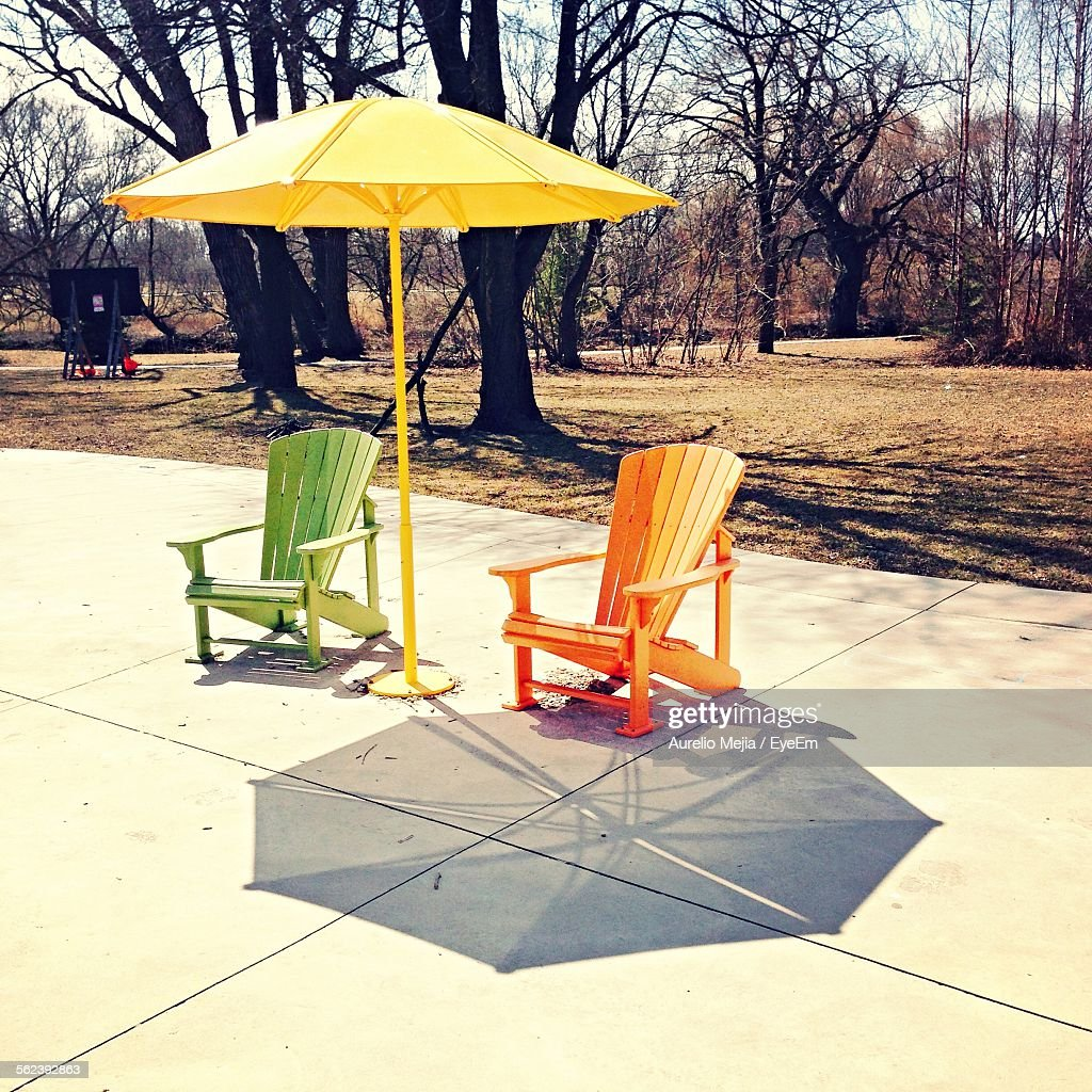 Green And Orange Lawn Chairs With Sunshade : Stock Photo