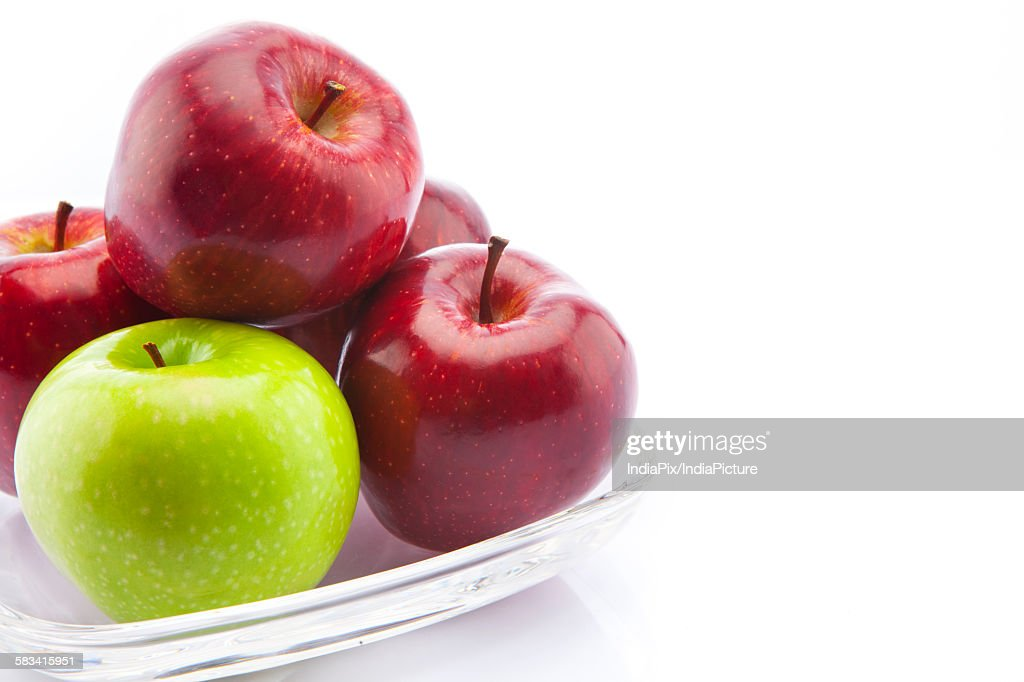 Green and red apples in a bowl : Stock Photo