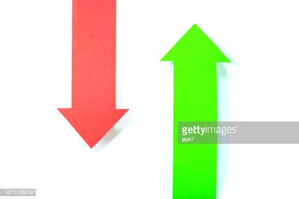 green and red arrow signs - arrow stock photos and pictures