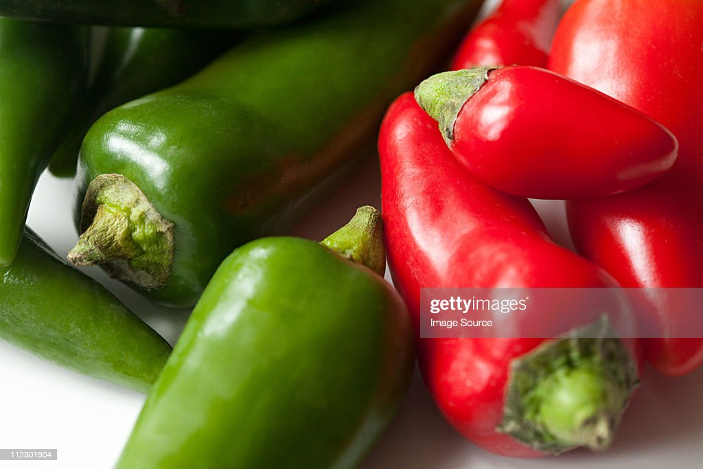 Green and red chilli peppers : Stock Photo