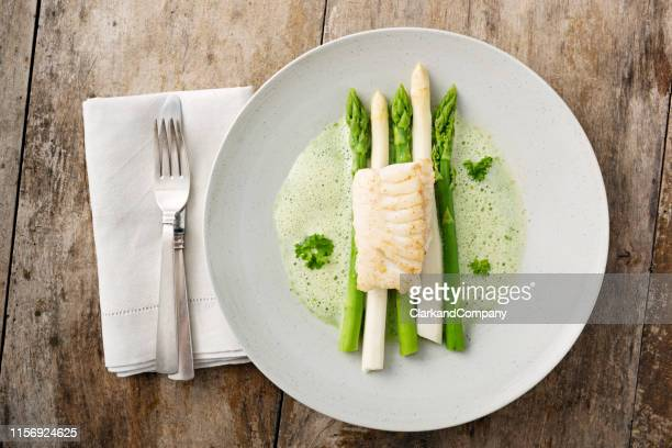 green and white asparagus with cod. - plate stock pictures, royalty-free photos & images