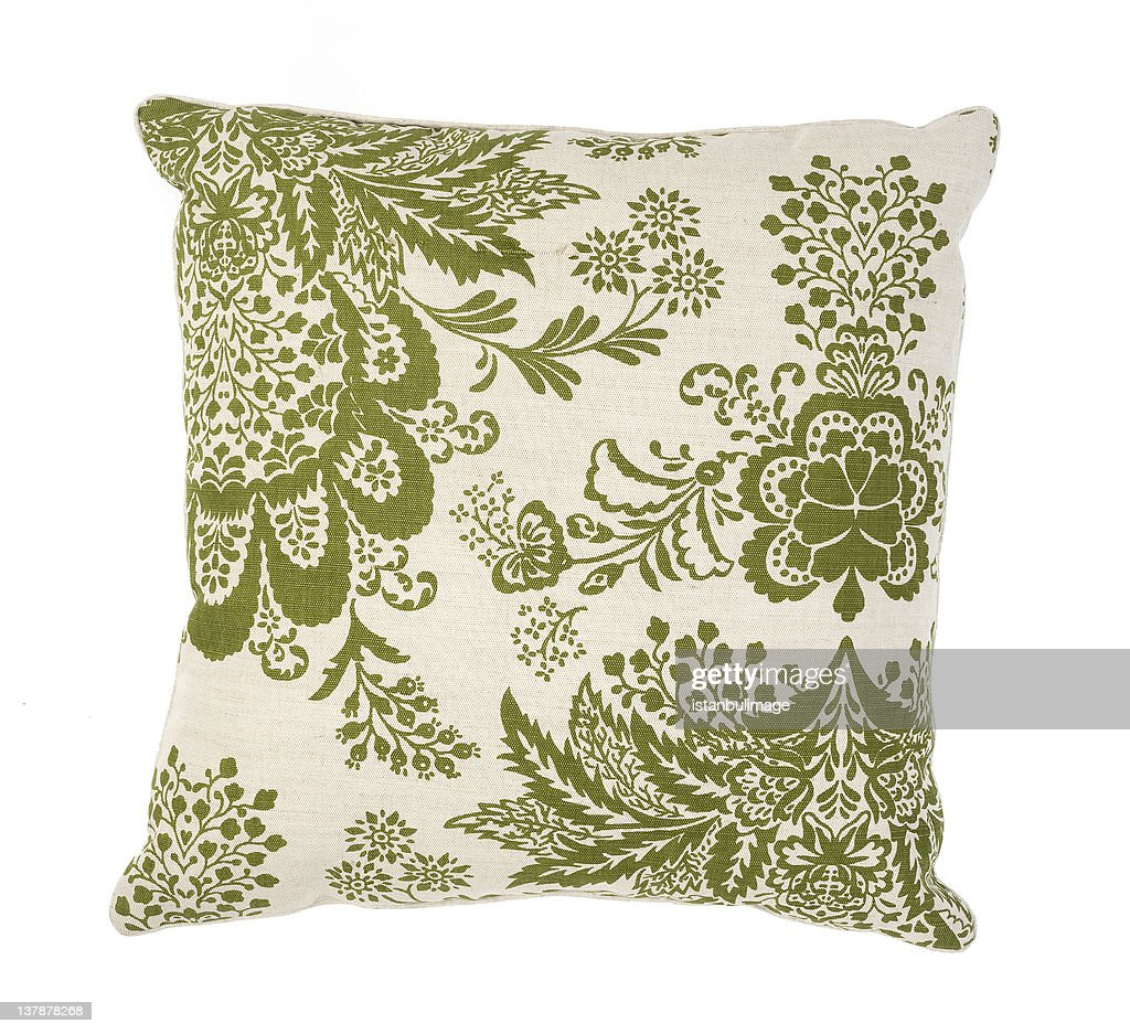 Green and white couch pillow with a floral pattern : Stock Photo