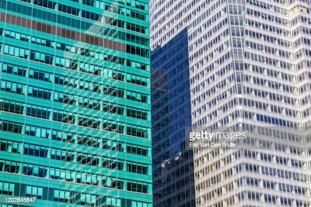 green and white office buildings - eric van den brulle stockfoto's en -beelden