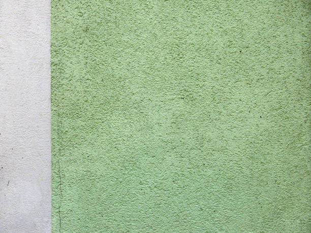 Green and white wall with texture and patina in Haute-Savoie