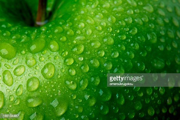 green apple detail - apple fruit stock photos and pictures