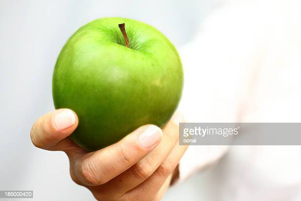 Green apple en mano