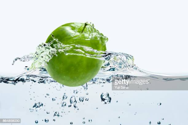 Green apple Jumpping out  from water.