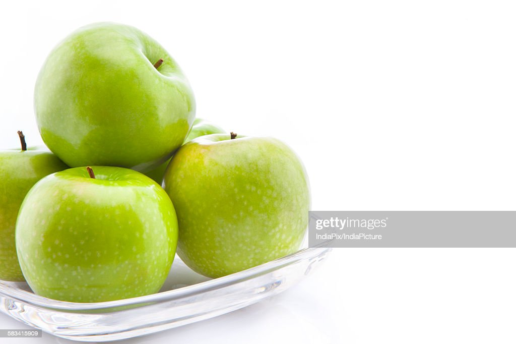 Green apples in a bowl : Stock Photo