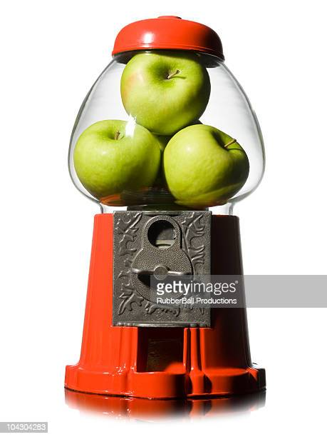 green apples in a gumball machine - gumball machine stock pictures, royalty-free photos & images