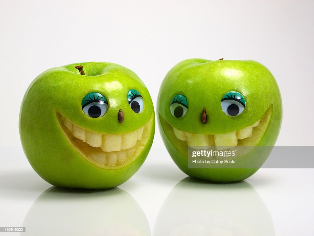 Green apples with smiling faces : Stock Photo
