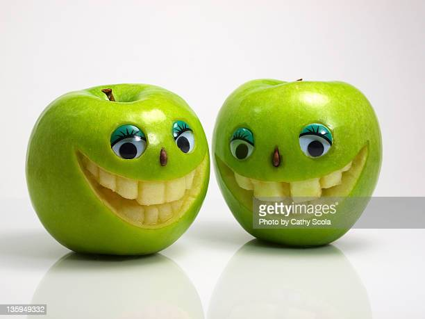 Green apples with smiling faces