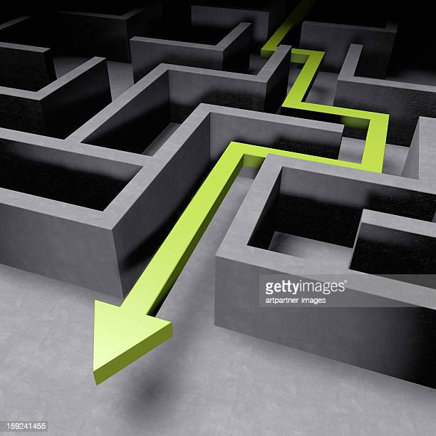 Green arrow showing the way out of maze