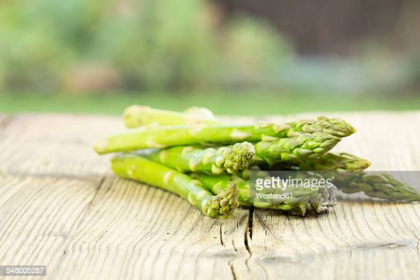 Green asparagus on wooden table