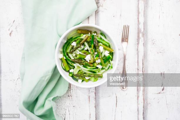 Green asparagus salad with helically coiled cucumber and feta cheese