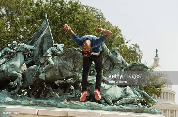 J Green attempts a back flip while practicing a dance routine at the Grant Memorial He is part of a dance group called the Nexx Level Boyz that...