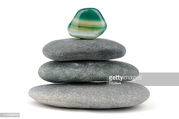 green aventurine gemstone on piled black stones - quartz stock pictures, royalty-free photos & images
