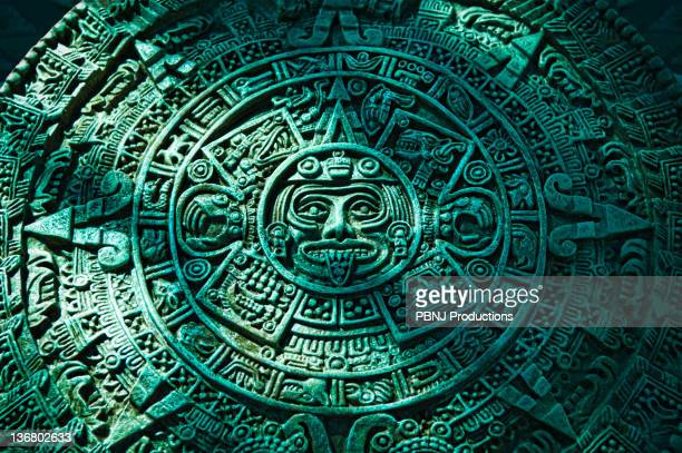 green aztec calendar stone carving - aztec civilization stock photos and pictures