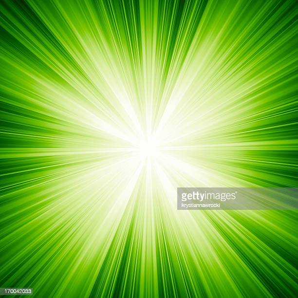 A green background with white light