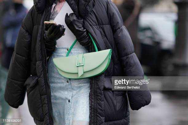 A green bag is seen outside Alexandre Vauthier during Paris Fashion Week Haute Couture Spring Summer 2020 on January 22 2019 in Paris France