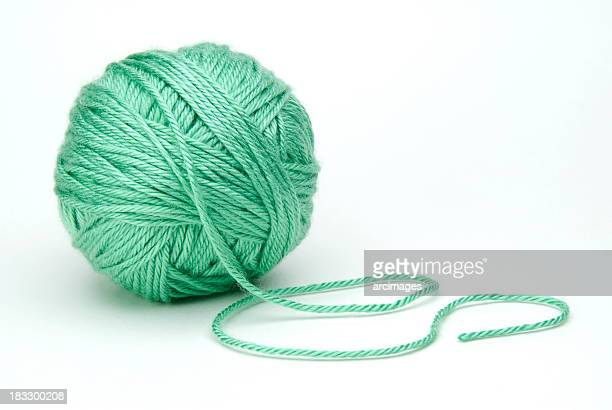 green ball of yarn on white background