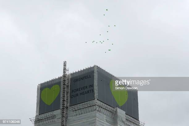 Green balloons are released over Grenfell Tower on the one year anniversary of the Grenfell Tower fire on June 14 2018 in London England In one of...