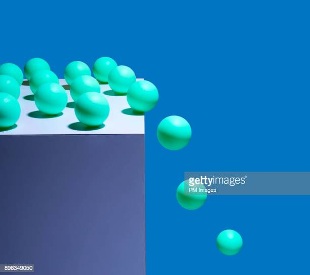 Green balls falling from box