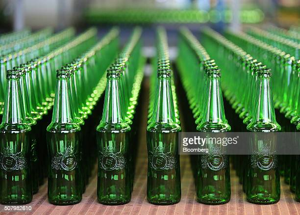 Green Baltika brand beer bottles move along the production line at the Ruscam Kirishi OJSC glass manufacturing plant in Kirishi Russia on Monday Feb...