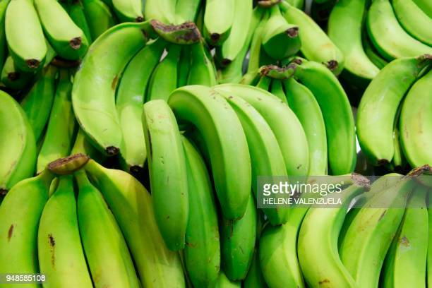 Green bananas are pictured at the fruit and vegetable department of an 'O Marche' supermarket in SaintFrancois on the French overseas territory of...
