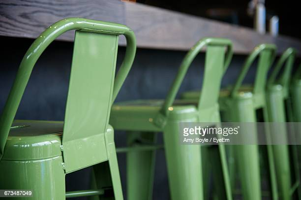 Green Barstools Arranged By Counter