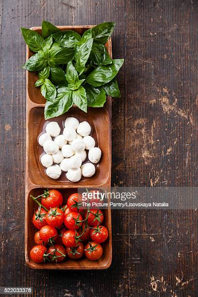 Green basil, white mozzarella, red tomatoes - Italian flag color