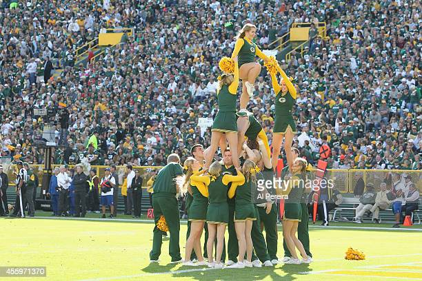 Green Bay Packer cheerleaders perform during the game between the Green Bay Packers and the New York Jets at Lambeau Field on September 14 2014 in...