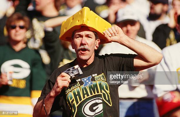 Green Bay Packer fan displays his cheese head during a 1990 San Francisco, California, Championship football game at Candlestick Park.