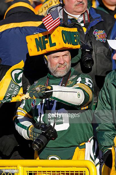 Green Bay Packer fan Steve Tate waits for the players to enter Lambeau Field during the Packers victory ceremony on February 8 2011 in Green Bay...