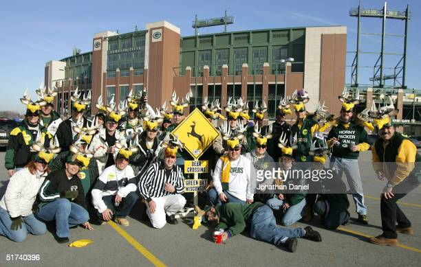 Green Bay Packer fans pose in the parking lot of Lambeau Field with deer hats with cheese wedges before a game between the Packers and the Minnesota...