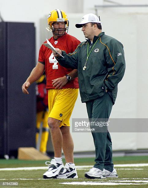 Green Bay Packers' Brett Favre talks with new head coach Mike McCarthy before the start of the first mini camp at the Don Hutson Center on May 5,...