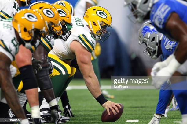 Green Bay Packers center Corey Linsley prepares to snap the ball during the first half of an NFL football game against the Detroit Lions in Detroit...