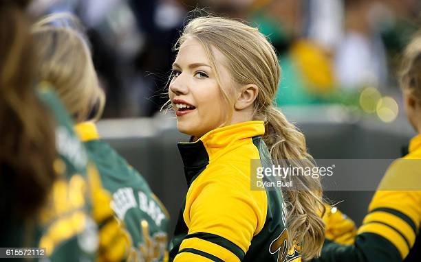 Green Bay Packers cheerleader cheers in the fourth quarter against the Dallas Cowboys at Lambeau Field on October 16 2016 in Green Bay Wisconsin