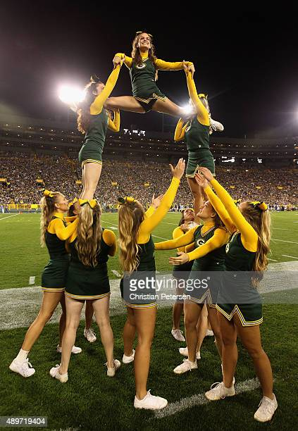Green Bay Packers cheerleaders perform during the NFL game against the Seattle Seahawks at Lambeau Field on September 20 2015 in Green Bay Wisconsin