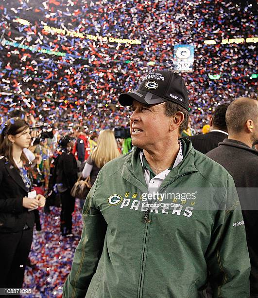 Green Bay Packers coach Mike McCarthy watches the celebration at the end of Super Bowl XLV where the Green Bay Packers beat the Pittsburgh Steelers...