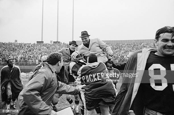 Green Bay Packers Coach Vince Lombardi is hauled up on the shoulders of his players and carried of the field after the Packers defeated the New York...