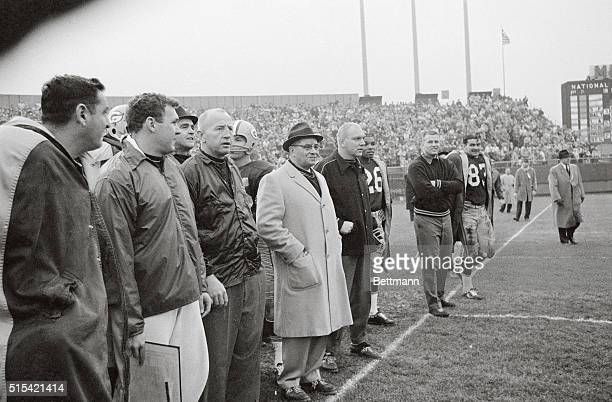 Green Bay Packers Coach Vince Lombardi is shown here on the sidelines only a short time before he is hauled up on the shoulders of his players and...