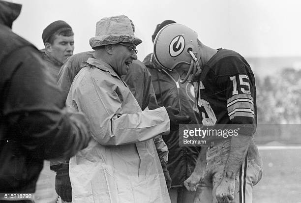 Green Bay Packers coach Vince Lombardi manages a smile near the end of NFL title game against the Cleveland Browns. Lombardi is talking to his QB...