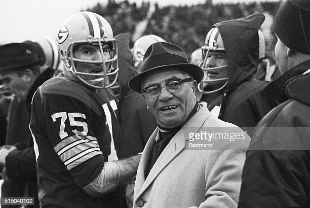 Green Bay Packers coach Vince Lombardi with palyers after defeating the Los Angeles Rams, 28-7 to win the NFL Western Conference play-off.