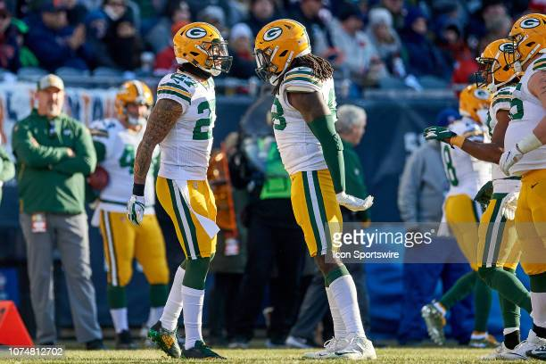 Green Bay Packers cornerback Tramon Williams celebrates with Green Bay Packers defensive back Josh Jones and teammates after a play in action during...